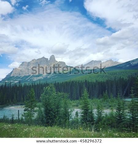 Summer landscape. River, trees and mountains. Instagram effects. - stock photo