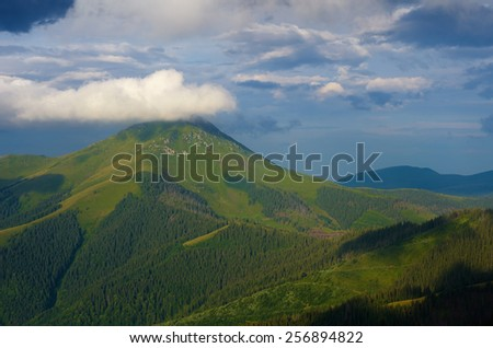 Summer landscape. Sunny day. Cloud over the mountain. Carpathians - stock photo