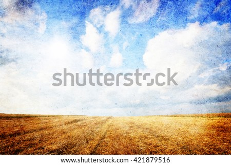 Summer landscape - Wheat field and blue sky with clouds- vintage style - stock photo