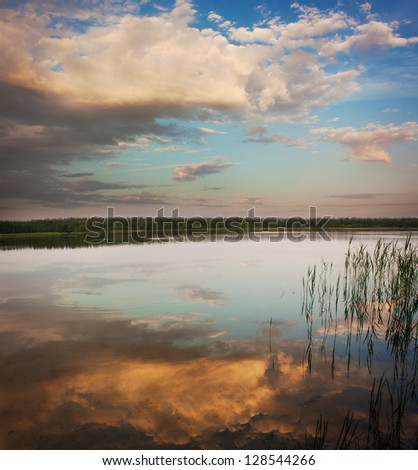 Summer Landscape with Calm Lake at Sunset - stock photo