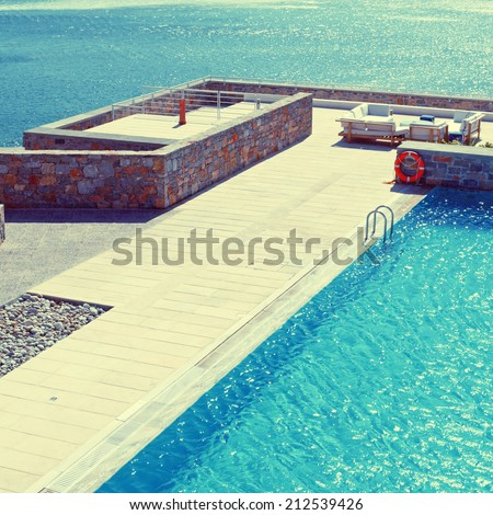 summer landscape with Mediterranean sea, pool and terrace in luxury resort (Greece), instagram effect, square image - stock photo