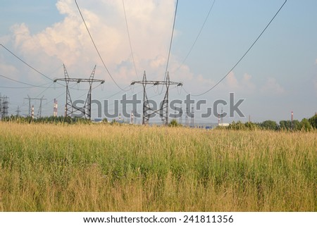 Summer landscape with power line, Russia.