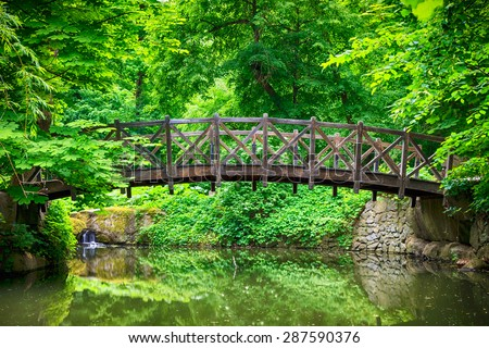 summer landscape with river in green forest - stock photo