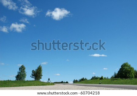 summer landscape with road and sky - stock photo