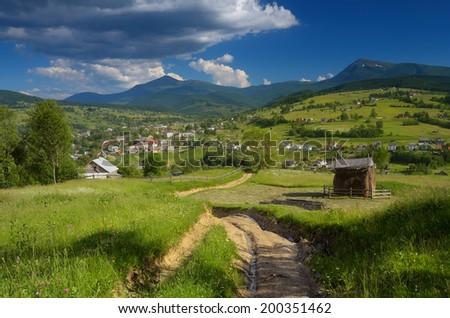 Summer landscape with road in a mountain village. Carpathians, Ukraine, Europe - stock photo
