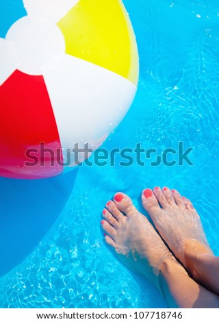 Summer leisure in a pool - stock photo
