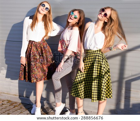 Summer lifestyle portrait of tree pretty young woman friends having fun together,nice summer day at vintage colors,three hipster girls enjoy their vacation,ready for party.shopping girls,party people - stock photo