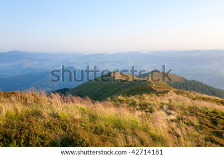 summer misty mountain landscape with christian cross on top (Ukraine, Carpathian Mountains)