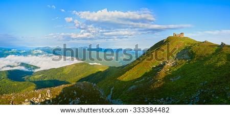 Summer morning panorama view on Pip Ivan mountain top with  observatory ruins (Chornogora Ridge, Carpathian, Ukraine). - stock photo