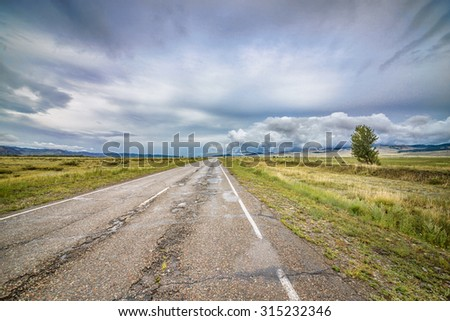 summer mountain and hazy sky landscape with road  - stock photo