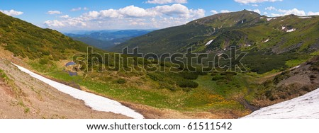 Summer mountain view with snow on mountainside (with observatory ruins on Chornogora Ridge, Ukraine). Five shots stitch image.