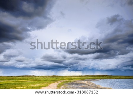 summer mountains and hazy sky landscape with road - stock photo