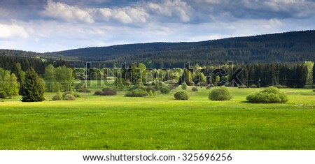 Summer mountains green grass and blue sky - stock photo