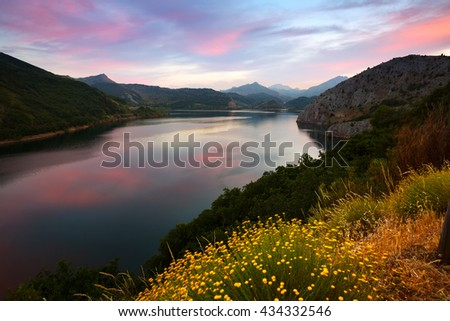Summer mountains landscape with lake in sunset.  Leon,  Spain