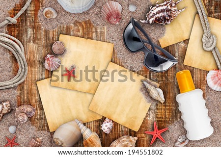 Summer necessities on old wooden background