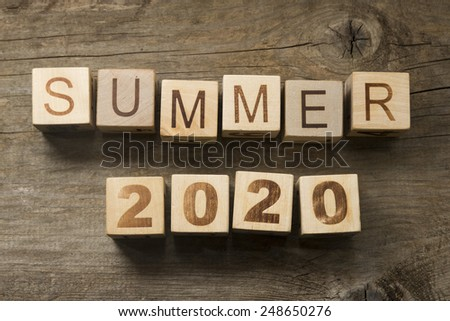 Summer 2020 on a wooden background - stock photo