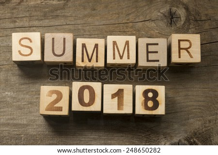 Summer 2018 on a wooden background - stock photo