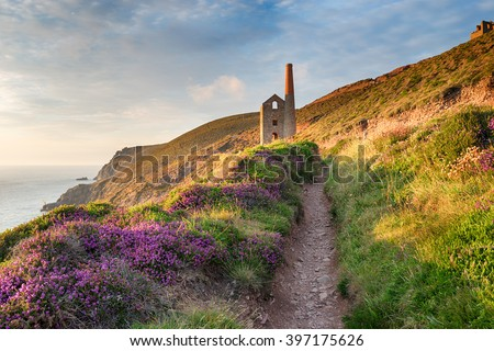 Summer on the South West Coast Path at Wheal Coates as it approaches St Agnes Head on the Cornwall coast - stock photo