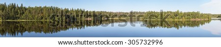 Summer panorama of forest lake with reflections - stock photo