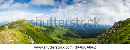Summer panorama of Montenegrin mountain range - stock photo