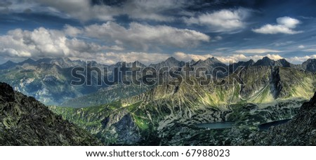 Summer panorama of mountains above the clouds. View of the High Tatras from Zadni Granat. Eagle Path.