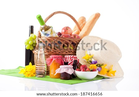 Summer picnic with a basket of food - stock photo