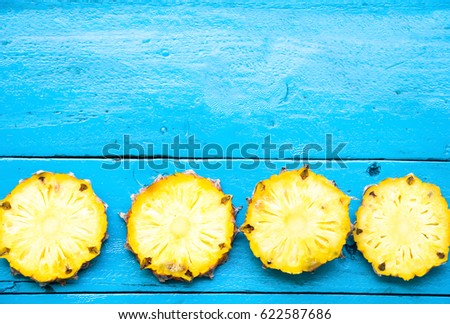 summer pineapple is slice for eat on blue wooden background. copy space for designer