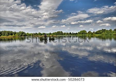 summer pond under blue sky background - stock photo