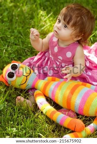 Summer portrait of beautiful baby girl - stock photo