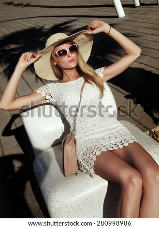 Summer portrait of blonde beautiful woman. Girl posing in fashionable sunglasses and hat. - stock photo