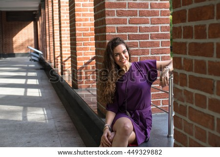 Summer portrait of fashion of the graceful sexy woman, wearing a magnificent fashionable lovely violet dress, bright, makes, the brunette's hair, stating only one travel in the downtown, pleasure, - stock photo