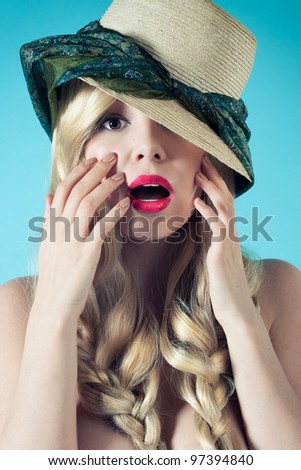 Summer portrait of surprised girl in a hat and scarf fun - stock photo