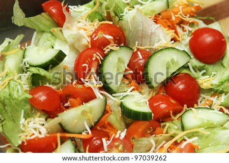 summer salad with cucumber, tomato and cheese - stock photo