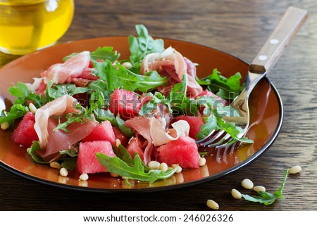 Summer salad with water-melon and prosciutto. - stock photo