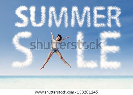 Summer sale clouds and woman jumping at  beach