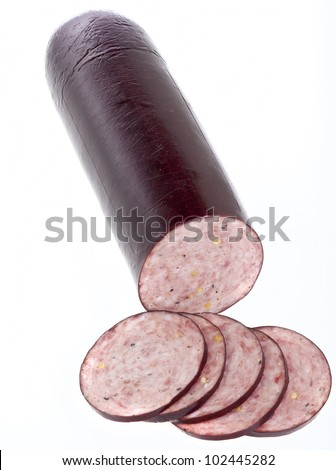 Summer sausage sliced and isolated on white. - stock photo