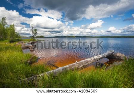 summer scene at lake shore, Ruunaa hiking area, Finland - stock photo