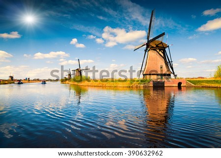 Summer scene in the famous Kinderdijk canal with windmills. Old Dutch village Kinderdijk, UNESCO world heritage site. Netherlands, Europe. - stock photo