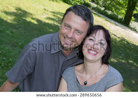 Summer scene of a happy middle aged couple