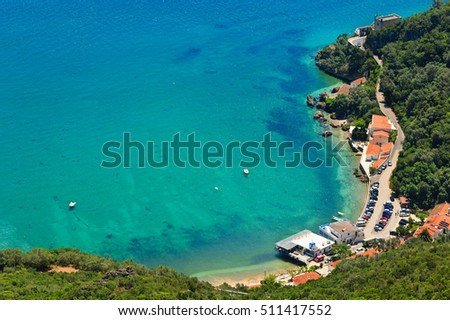 Summer sea coastal landscape with Portinho beach parking. Top view from Nature Park of Arrabida  in Setubal, Portugal.