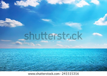 Summer sea with shiny sky with small clouds - stock photo