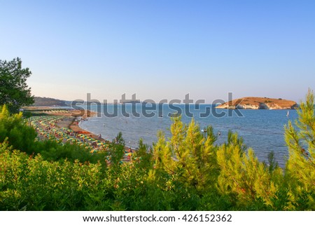 Summer seascape.Gargano coast: bay of Vieste.-(Apulia) ITALY-Portonuovo  beach is a succession of fine sand dunes,crossed by many little kars streams,that cool the visitors in the hot summer time. - stock photo