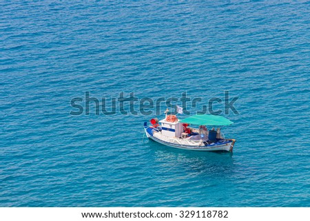 summer seascape with small blue fishernan boat
