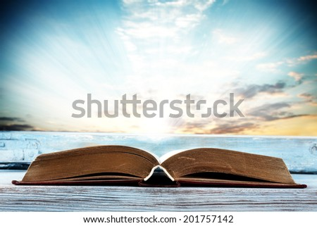 summer sky and book  - stock photo