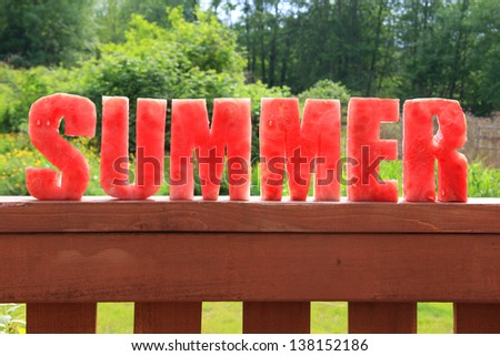 Summer spelled in letters cut out of watermelon. - stock photo