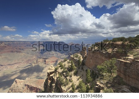 Summer storm clouds over Grand Canyon - stock photo