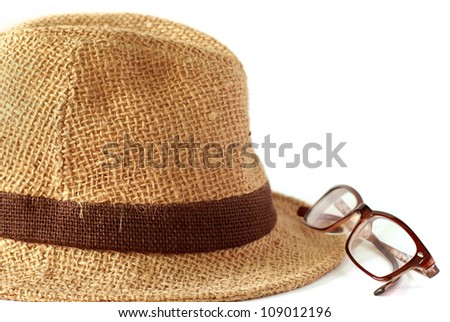 Summer straw hat with glasses on white background - stock photo