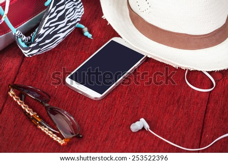 summer stuff scattered on the bed - stock photo