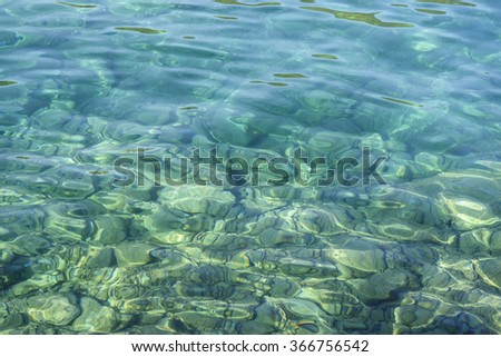 Summer, sun. Azure, turquoise, amazing clear seawater. Flecks of sunlight in seawater of Adriatic Sea. Background. Marine landscape - stock photo