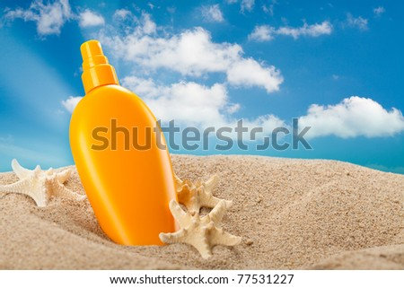 Summer sunbath - suntan oil - stock photo